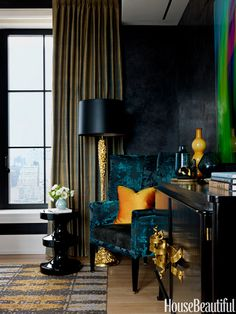 "Dazzling Dark Walls : ""Reflective surfaces and jewel tones give a young woman's bedroom in a New York apartment designed by Jamie Drake a dazzling richness. Angelo's wing chair in Sansui fabric, Donghia. Curtains, New Khmer by Jim Thompson."""