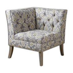 Чудесное угловое кресло с ярким узорчатым принтом. Кресло будет прекрасно смотреться в одиночку, а в паре оно создаст небольшой уютный диванчик. Высота сиденья 51 см.             Метки: Кресла для дома, Кресло для отдыха.              Материал: Ткань, Дерево.              Бренд: Uttermost.              Стили: Прованс и кантри.              Цвета: Светло-серый, Серый.