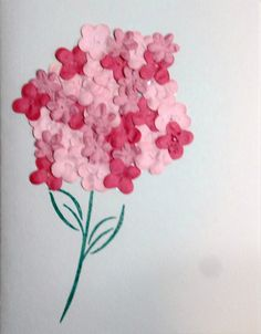Looks hard, but it's not. Stamp, or draw, a flower stem with green ink. With pencil lightly draw a circle the size you want your flower to be, then either spread glue lightly over the area or use double-sised tape. Use 3 shades of tiny paper flowers and cover the surface and there you have it - a hydrangea! You can add any sentiment when you use the card.
