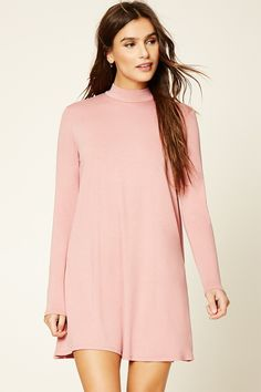 A stretch-knit shift dress featuring a high neckline and long sleeves.