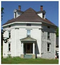 This octagon house in     central Maine awaits restoration. Dormer windows are unusual for this style     house, which usually included a cupola.      -- Photo: Deb Holmes