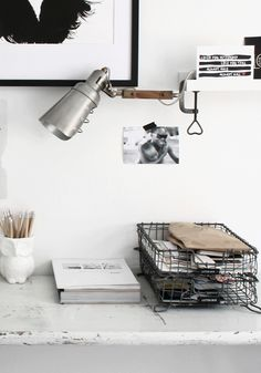 wall mounted light to save some desk space - I love the idea of this desk lamp to get it off the desk
