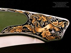 Jack Busfield made knives engraved by Steve Lindsay