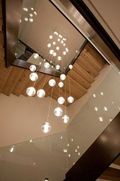 Casa Country Club / Ezequiel Farca Chandelier In Living Room, Ball Lights, Pendant Lighting, Sweet Home, New Homes, Ceiling Lights, Interior Design, Architecture, House Styles