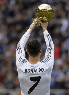 Cristiano Ronaldo shows off his FIFA Ballon D'Or to the Real Madrid crowd at the Estadio Santiago Bernabéu.
