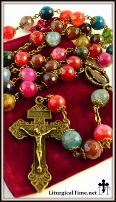 See all rosaries Genuine Stone Rosary w/Catholic style crucifix. FREE SHIPPING! Genuine handmade agate and bronze tone rosary with full bead caps. Catholic style crucifix and Madonna center. Large 10