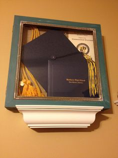 Found a perfect shadow at Home Goods for $16.99 that fits all my graduation goodies in it to display in my room! ...Instead of putting it in a box in the top of my closet!