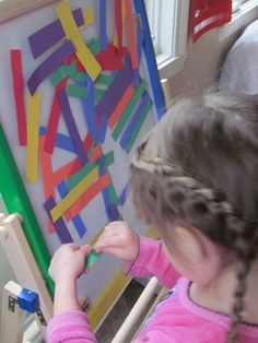 Sticky easel and strips of paper