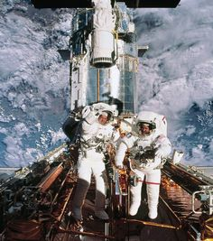 Hubble service mission. Two space-walkers with visors up!