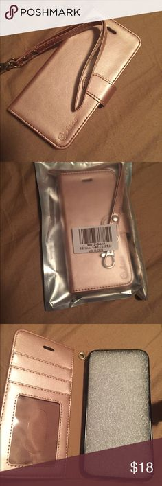 New iPhone wristlet So cute ! Brand new rose gold iPhone 6 holder and wristlet ! This has Id and credit card slots and a case for the iPhone. Accessories