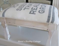 Vintage grain sack as bench upholstery