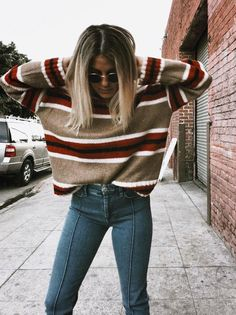 Cozy fall inspired outfit, mustard yellow + red striped jumper woth pin striped jeans. Trendy outfits for women. #fashion