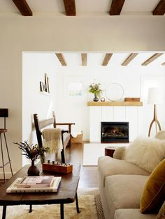 Neutral Living Room With Wood Beams And Fireplace