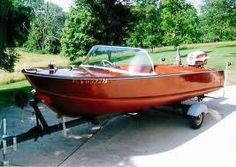 vintage outboard speed boat....