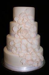 Floral blossom wedding cake, coral tipped pedals to match bridal colors