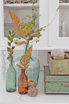 vibek design, fall leaves, glasses, fall mantels, decorating ideas, glass jar, vintag glass, water bottles, colored glass