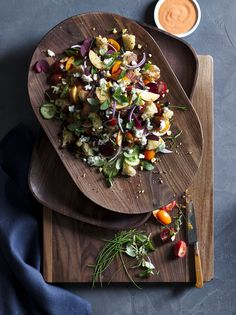 Reversible salad board from Chef Tyler Florence. Chop on one side and serve on the other! Beautiful, sustainable walnut wood. Made in the USA.