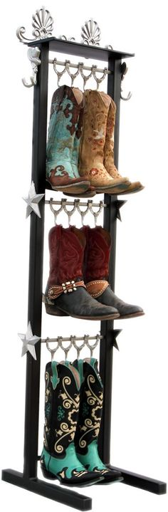 Boot Rack for 3 to 6 pair of cowboy boots. The boot rack comes with silver boot hooks in the shape of horse shoes, 2 decorative silver belt hooks and silver stars on each side. $299