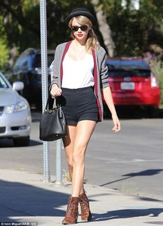 Taylor Swift wearing Cooperative High Waisted Denim Shorties Ray-Ban RB4165 Justin Sunglasses Free People Patton Pork Pie hat in Black Frye Courtney Boots in Cognac Dolce & Gabbana Sara bag