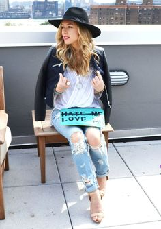 Master the effortlessly chic look in a black leather jacket and light blue ripped boyfriend jeans. Add beige leather heeled sandals to your look for an instant style upgrade.  Shop this look for $109:  http://lookastic.com/women/looks/jacket-long-sleeve-blouse-hat-clutch-boyfriend-jeans-heeled-sandals/4710  — Black Leather Jacket  — White Silk Long Sleeve Blouse  — Black Wool Hat  — Light Blue Print Leather Clutch  — Light Blue Ripped Boyfriend Jeans  — Beige Leather Heeled Sandals