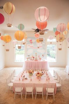 "I love the hot air balloon idea. Create one stunning eye-catching display by hanging paper lantern hot air balloons from the ceiling. This is a great idea for an ""Up In The Air"" baby shower or birthday party! Idee Baby Shower, Baby Shower Themes, Shower Ideas, Babyshower Themes For Girls, Baby Shower Table Set Up, Babyshower Decor, Baby Shower Chair, Baby Decor, Baby Shower Balloons"