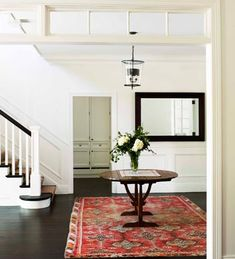 A Hamptons style entry is timeless. Simply change the rug and floral arrangement for a new look.