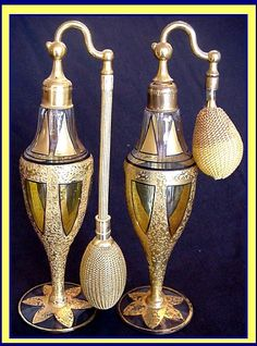Pair of Art Deco, early 20th century amber and gold glass perfume bottle atomisers. Devilbiss.