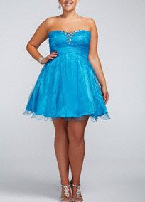 Bring a fresh look to homecoming in this stylish shortdress!  Strapless sweetheart bodice is outlined in beautiful chunky stone detail.  Fulltulle skirtadds drama and dimension.  Pair with ahigh heels and delicatejewelryto finish off the look.  Fully lined. Back zip. Imported polyester. Do not wash, do not dry clean, professionally spot clean only. Do not apply heat or steam to bead decoration. Available in Missy sizes as Style 480233.