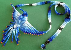 Mexican Huichol Beaded hummingbird necklace by Aramara on Etsy Bead Jewellery, Beaded Jewelry, Beaded Necklace, Bead Crochet Patterns, Beading Patterns, Hummingbird Necklace, Seed Bead Projects, French Beaded Flowers, Beaded Boxes