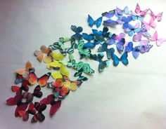 The Original EDIBLE BUTTERFLIES  - Rainbow Collection - set of 50 small - Cake & Cupcake toppers - Food Accessories. $19.90, via Etsy.