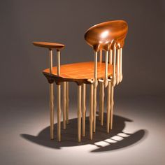 Chair carved from mahogany and maple.