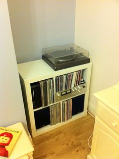 """A mildly hacked Ikea """"Expedit"""" shelving unit is a surprisingly snug home for my Hi-fi and my vinyl collection (even the records). Vinyl Storage, Record Storage, Record Shelf, Expedit Hack, Vinyl Record Player, Vinyl Records, Ikea Hackers, Diy Tv, Entertainment Center"""