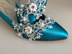 Vintage blue shoes which we dyed to this colour and added all the details.