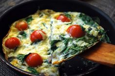 Mini Breakfast Egg, Tomato, and Spinach Flatbread Pizza from 50 Vegetarian Recipes for Meatless Mondays — or Any Other Time