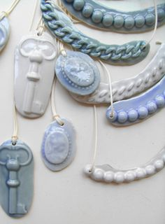 beautiful porcelain jewelry in lovely muted colors like blues, grays and whites #porcelain #necklaces