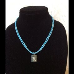 "Initial ""M"" Beaded Necklace Aqua Blue beaded initial ""M"" necklace. ""M"" is carved into a stone medallion. Boutique Purchase Jewelry Necklaces"