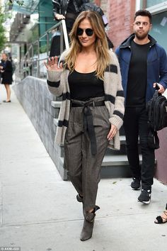 Best foot forward: Jennifer Lopez wore a fuzzy striped cardigan while out in New York Mond...
