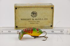 """Wright McGill Flapper Crab Lure - <a href=""""http://www.finandflame.com/wright-mcgill-flapper-crab-lure/"""" rel=""""nofollow"""" target=""""_blank"""">www.finandflame.c...</a> - <a class=""""pintag searchlink"""" data-query=""""%23AntiqueFishingLure"""" data-type=""""hashtag"""" href=""""/search/?q=%23AntiqueFishingLure&rs=hashtag"""" rel=""""nofollow"""" title=""""#AntiqueFishingLure search Pinterest"""">#AntiqueFishingLure</a>, <a class=""""pintag searchlink"""" data-query=""""%23AntiqueLure"""" data-type=""""hashtag"""" href=""""/search/?q=%23AntiqueLure&rs=hashtag"""" rel=""""nofollow"""" title=""""#AntiqueLure search Pinterest"""">#AntiqueLure</a>, <a class=""""pintag"""" href=""""/explore/Bass/"""" title=""""#Bass explore Pinterest"""">#Bass</a>, <a class=""""pintag"""" href=""""/explore/Denver/"""" title=""""#Denver explore Pinterest"""">#Denver</a>, <a class=""""pintag"""" href=""""/explore/Fishing/"""" title=""""#Fishing explore Pinterest"""">#Fishing</a>, <a class=""""pintag"""" href=""""/explore/History/"""" title=""""#History explore Pinterest"""">#History</a>, <a class=""""pintag searchlink"""" data-query=""""%23WrightMcGillFlapperCrabLure"""" data-type=""""hashtag"""" href=""""/search/?q=%23WrightMcGillFlapperCrabLure&rs=hashtag"""" rel=""""nofollow"""" title=""""#WrightMcGillFlapperCrabLure search Pinterest"""">#WrightMcGillFlapperCrabLure</a> - Wright McGill Flapper Crab Lure The Wright McGill Flapper Crab Lure in first introduced around 1930. The Flapper Crab antique lure was made by The Wright and McGill Company out of Denver Colorado. The lure was available in a few different sizes. The Flapper Crab fishing lure was ma"""
