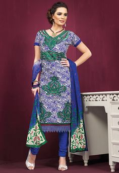 Blue and green art silk floral printed, resham embroidered and crochet patch bordered kameez with blue poly cotton churidar and blue faux chiffon dupatta. The unstitched kameez can be customized upto 42 inches. (Slight variation in color and patch border is possible.) data-pin-do=