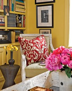 white chair with tan padding and red and white pillow in yellow room Rug, Yellow Walls, Built In Shelves, Cozy Place, White Pillows, Throw Pillows, Mellow Yellow, Room Inspiration, Family Room