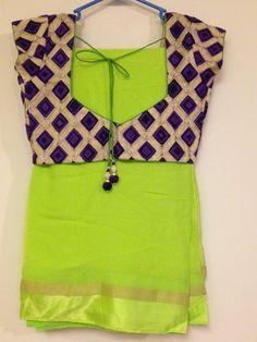 Neon green saree with blue contrast blouse
