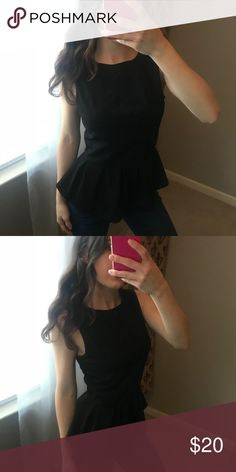 Black peplum top Black peplum top with a zip up back Tops