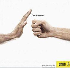 """Paper beats stone"" - Amnesty International"