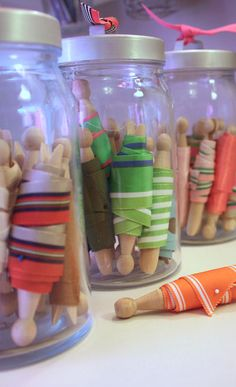 Organize | RIBBONS :: Keep your pretty ribbons from getting tangled with old fashioned clothespins & straight pins in jars. | #clothespins #masonjars #organize