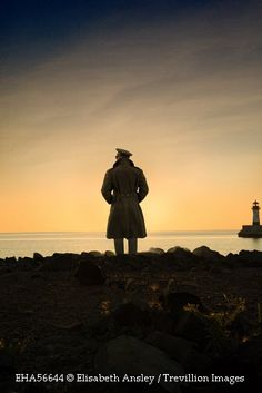 Trevillion Images - silhouette-of-soldier-looking-out-to-sea