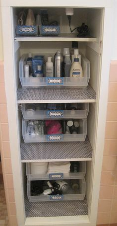 Neat Little Nest: Bathroom linen closet organization and storage solutions with DIY labels.