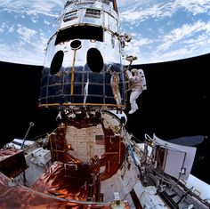 "humanoidhistory: ""December 1993 — Astronaut Story Musgrave works on the Hubble Space Telescope while the orbital observatory anchored to the Space Shuttle Endeavour. Story Musgrave, Edwin Hubble, Spitzer Space Telescope, Nasa Space, Nasa Photos, Mission To Mars, Space Race, International Space Station, Space Photos"