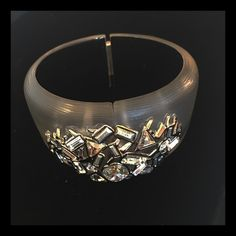 Alexis Bittar Crystal Encrusted Cuff Modern Glamour. I can't think of a better way to describe this hinged cuff. The hand painted lucite is further elevated by chunky crystals. Alexis Bittar Jewelry Bracelets