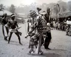 Africa | Dancers of the Nkanda age grade of the Leopard society, performing with the okum ngbe masquerader at a monenkim's coming-out ceremony. Ekwe Ejagham, Cameroon, 1988.|| Photo Ute M. Roschenthaler