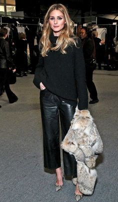 Olivia Palermo all black with wide leg leather pants and chunky knit. See more at www.HerFashionedLife.com